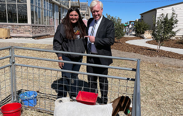 Superintendent checks out the goats in the pen