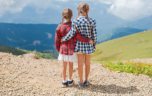 Two girls admire the mountain view