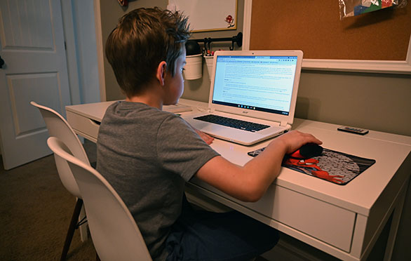 A student works on his online class
