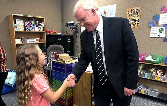 Superintendent Godfrey shakes a student's hand