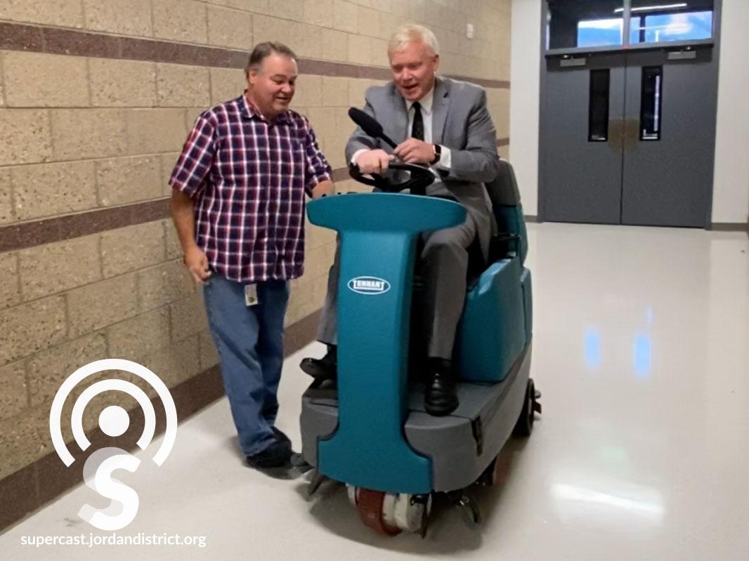 Superintendent Godfrey runs the floor cleaning machine