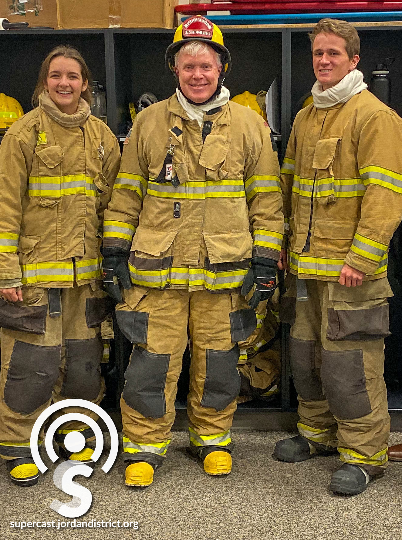 Superintendent Godfrey with two JATC Firefighter students