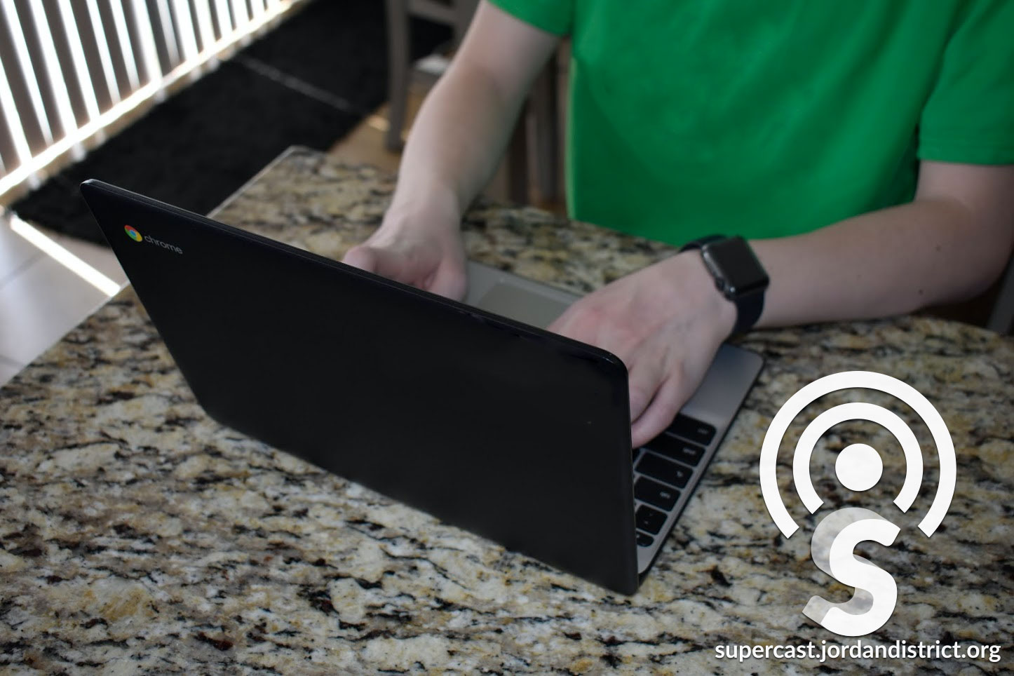 A student works on his Chromebook at home