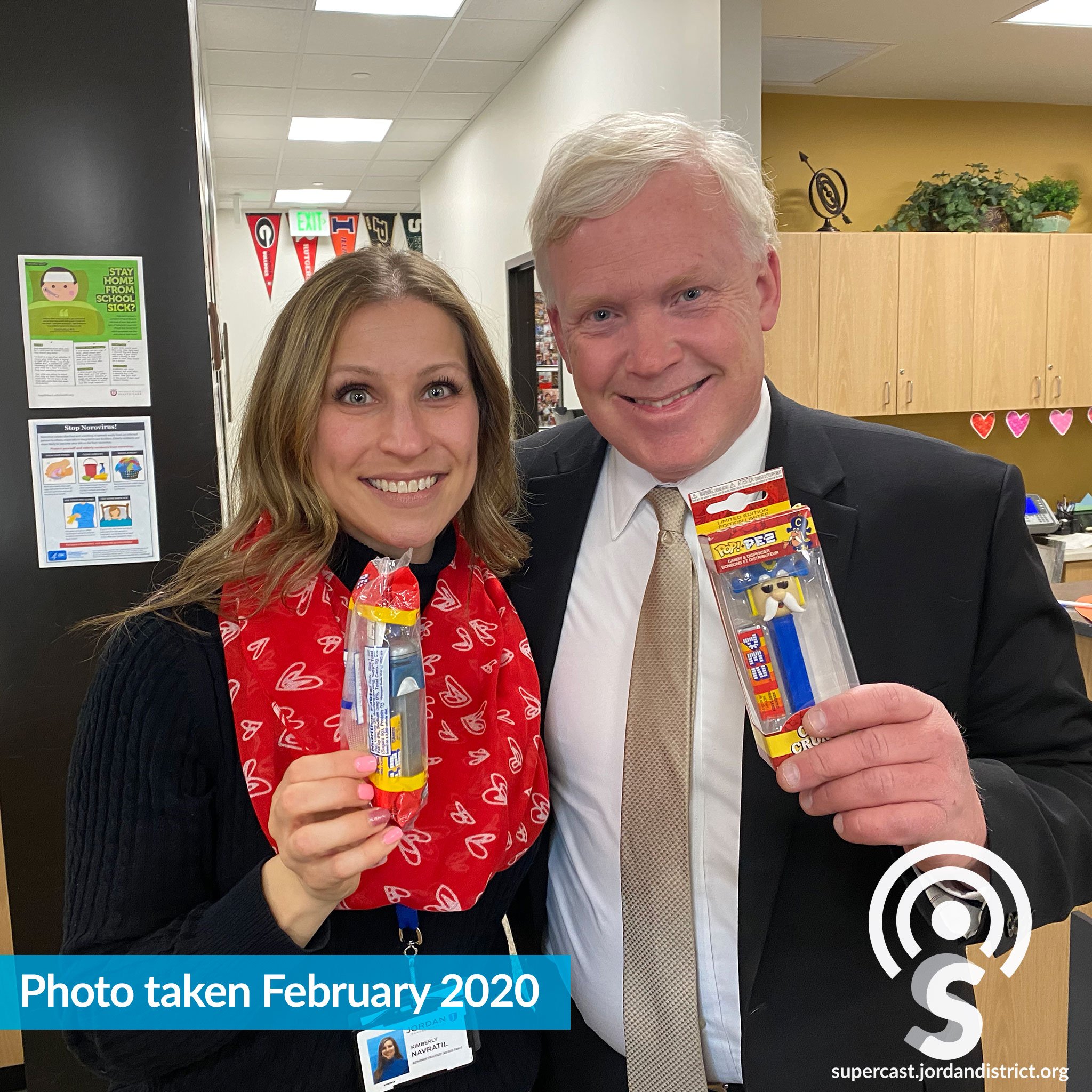 Superintendent & Kimberly hold up PEZ Dispensers