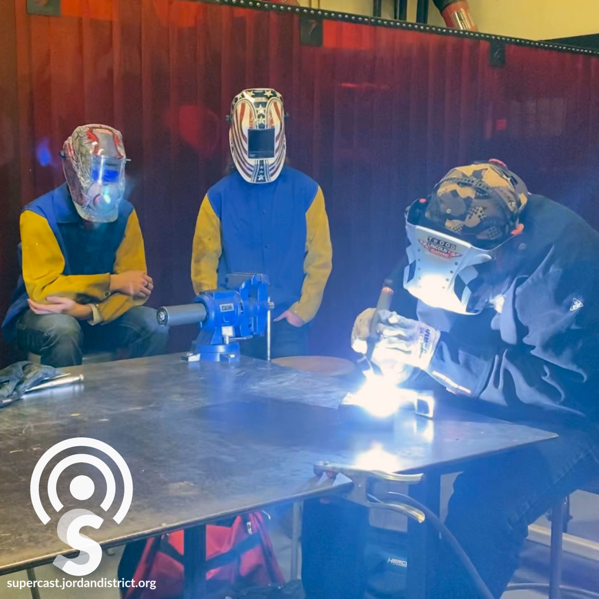 Students welding in class