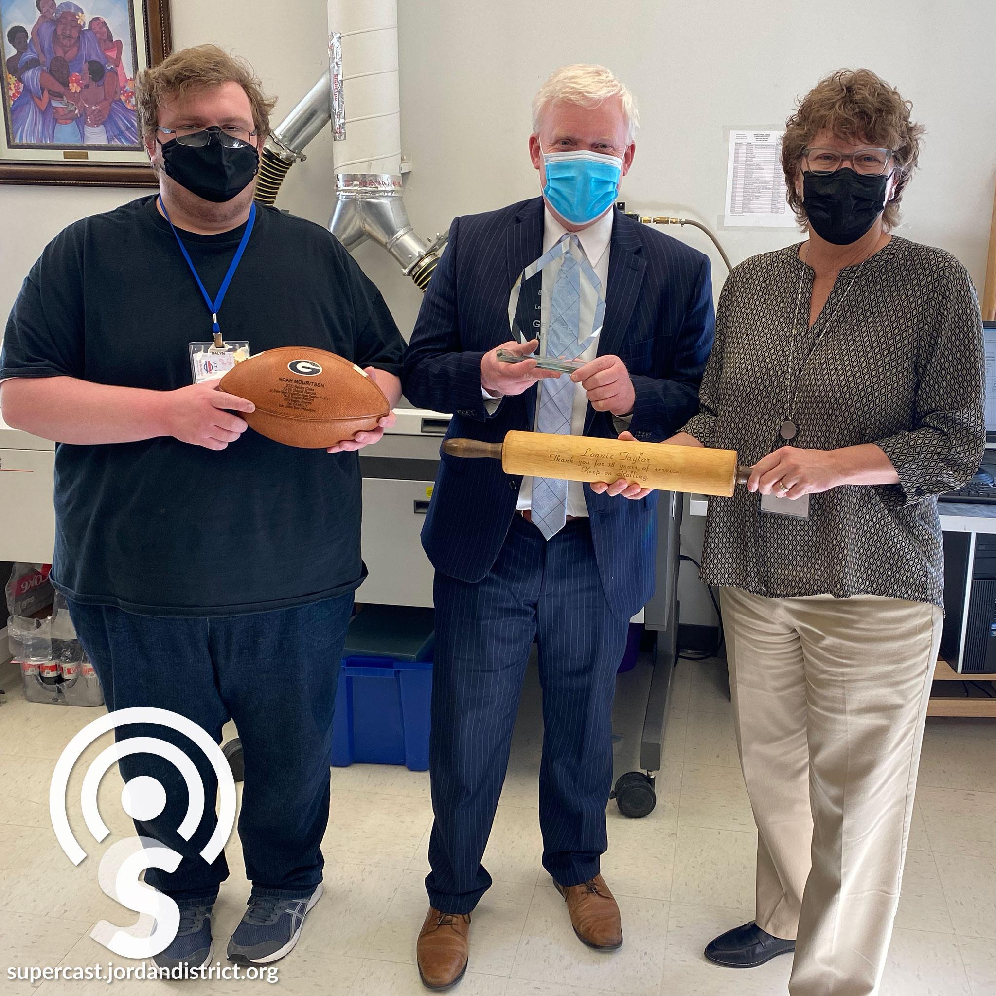 Superintendend & SVS Staff Show off some engraving work
