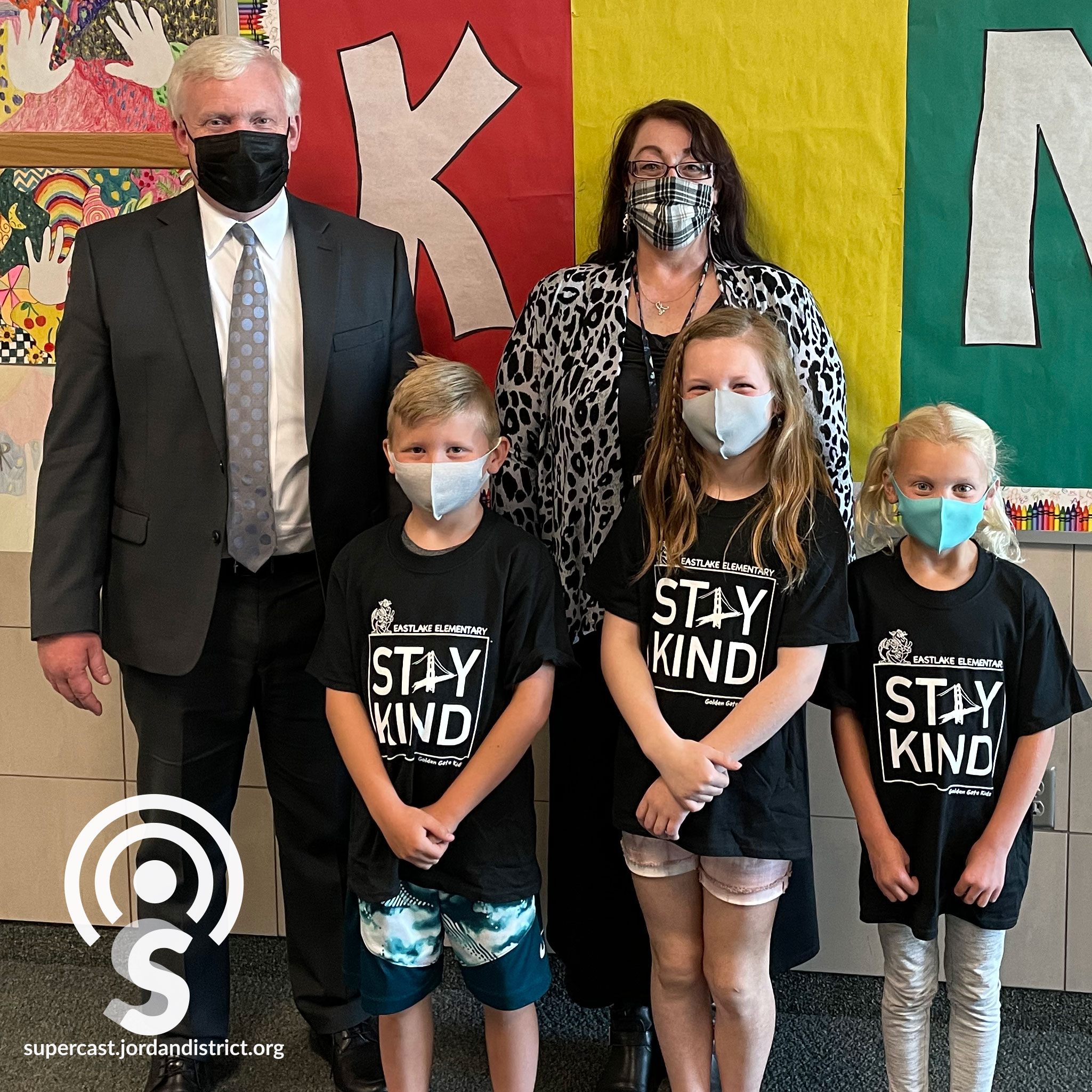 Superintendent stands with Eastlake's Stay Kind students