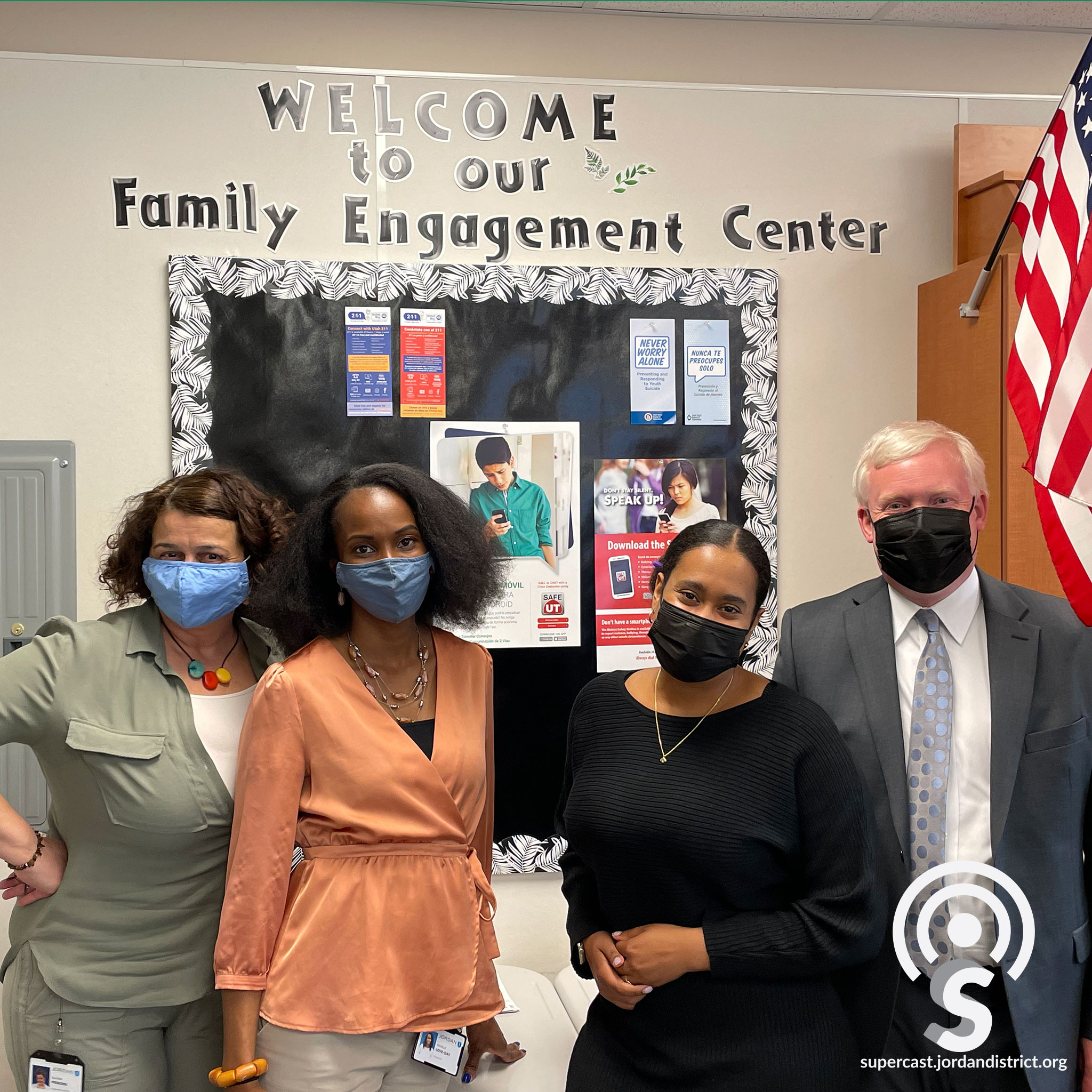 Family Engagement Center staff stand with Superintendent Godfrey