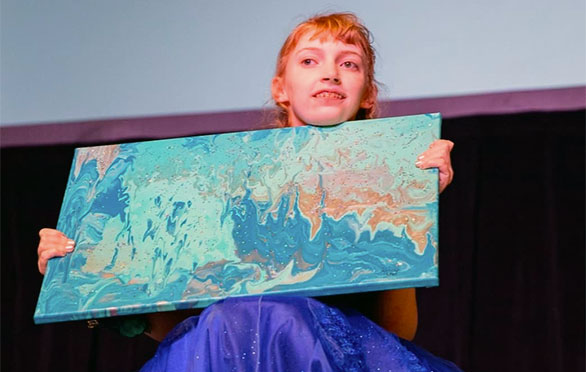 Kimmie Hansen shows her painting