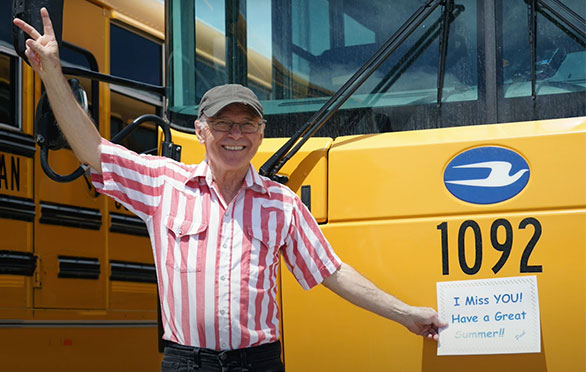 Bus driver Paul displays a sign outside his bus