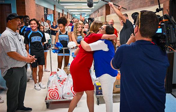 Robyn Luke gets a hug